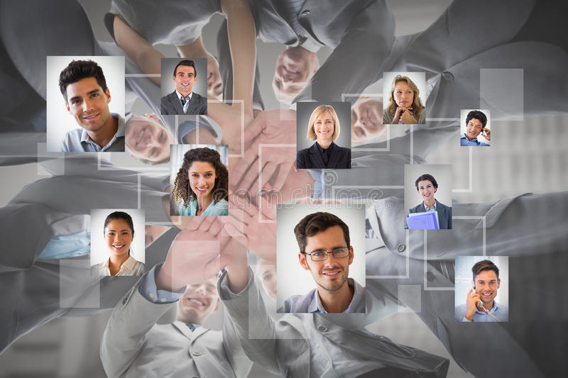 Composite image of smiling business team standing in circle hands together royalty free stock photo