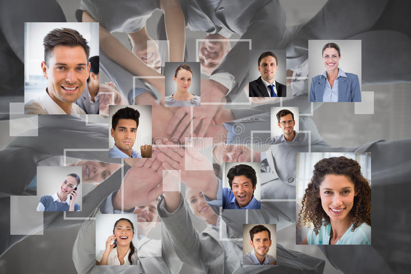 Composite image of smiling business team standing in circle hands together stock photography