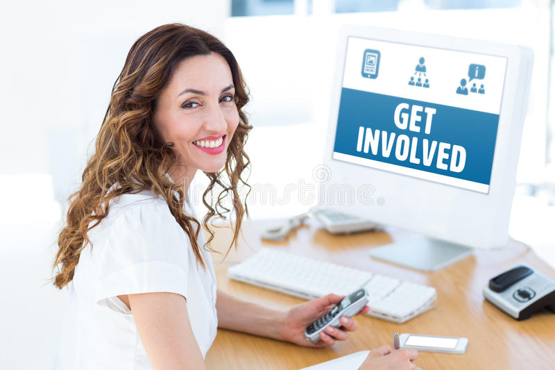 Composite image of smiling businesswoman looking at camera royalty free stock photography