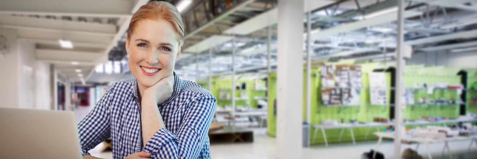 Composite image of smiling businesswoman sititng with laptop against white background stock photo