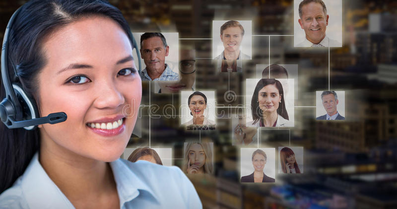 Composite image of smiling businesswoman using headset stock images
