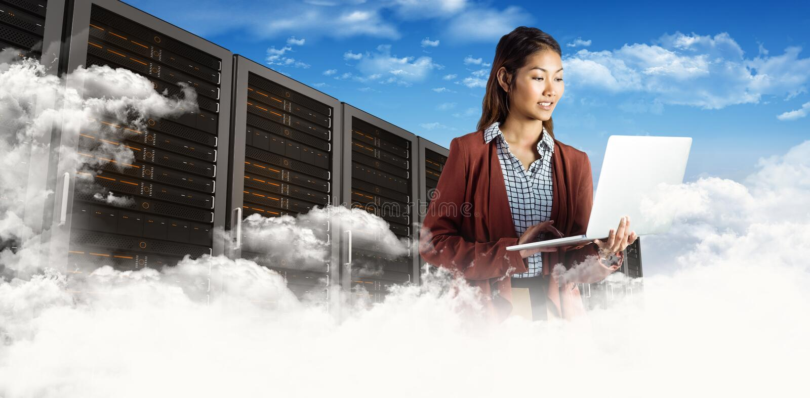 Composite image of smiling businesswoman using laptop stock photos