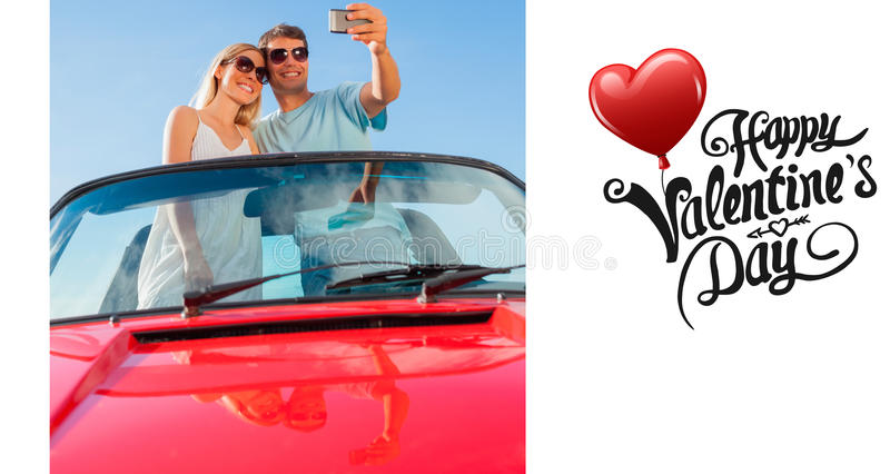 Composite image of smiling couple standing in red cabriolet taking picture. Smiling couple standing in red cabriolet taking picture against cute valentines vector illustration