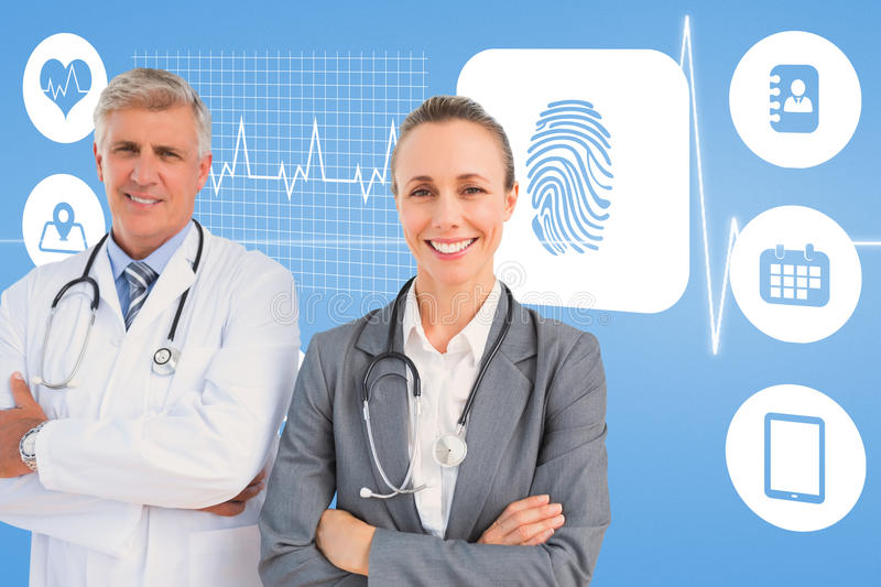 Composite image of smiling doctors with arms crossed. Smiling doctors with arms crossed against medical background with blue ecg line royalty free stock photos