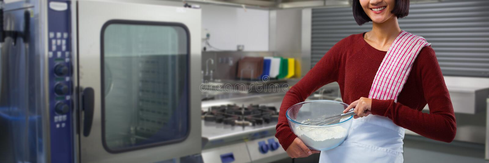 Composite image of smiling female chef mixing flour in bowl with whisk royalty free stock photos