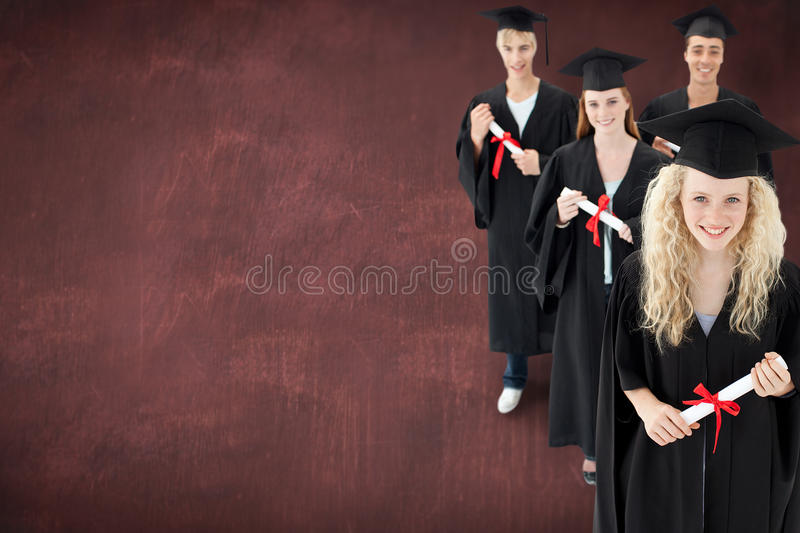 Composite image of smiling group of teenagers celebrating after graduation royalty free stock image