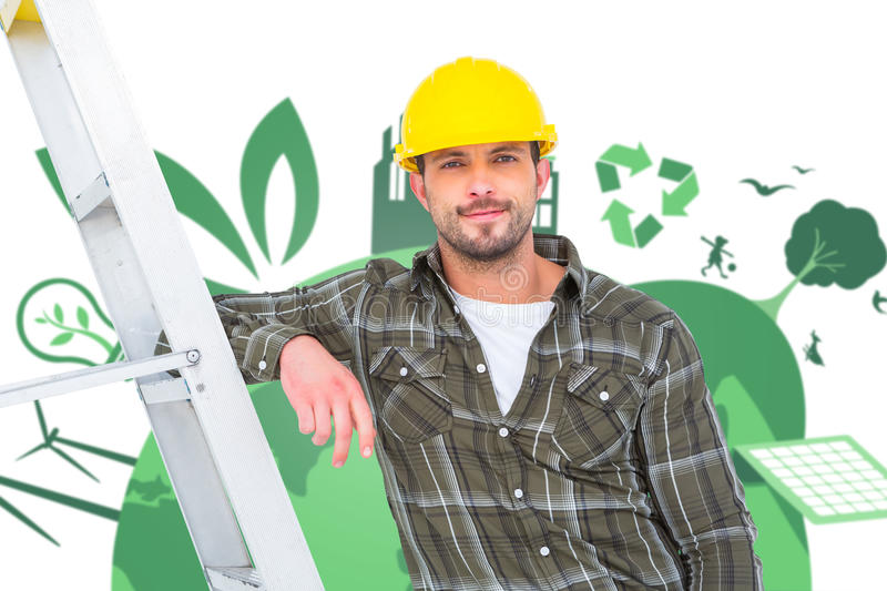 Composite image of smiling handyman in overalls leaning on ladder stock photography