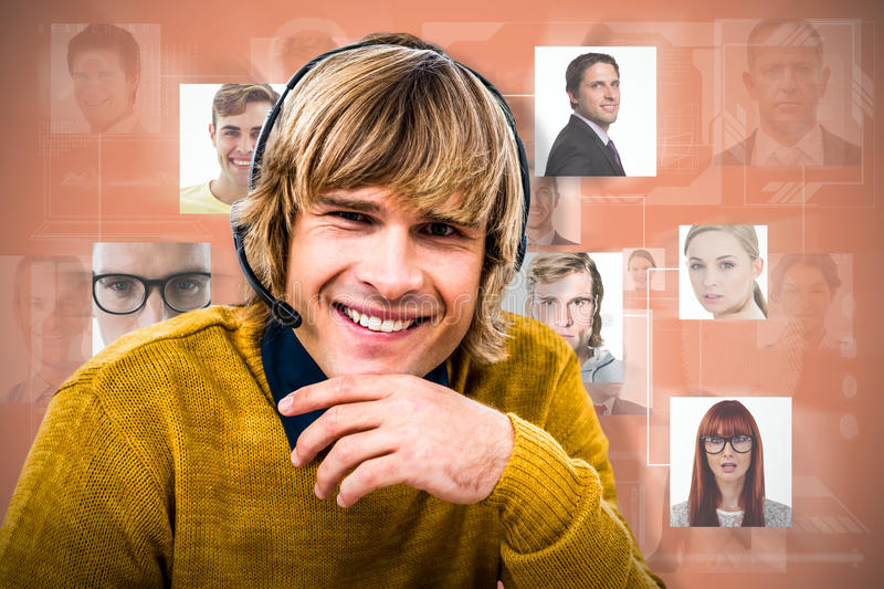 Composite image of smiling hipster businessman using headset royalty free stock photo