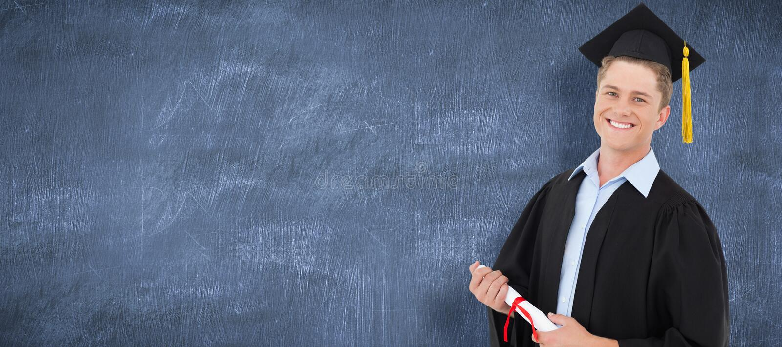 Composite image of a smiling man with a degree in hand as he looks at the camera stock photography