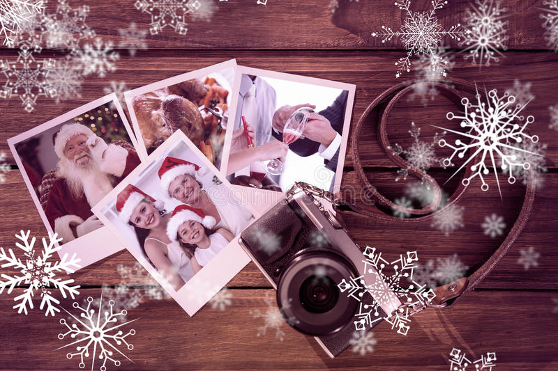 Composite image of smiling santa holding his glasses stock images