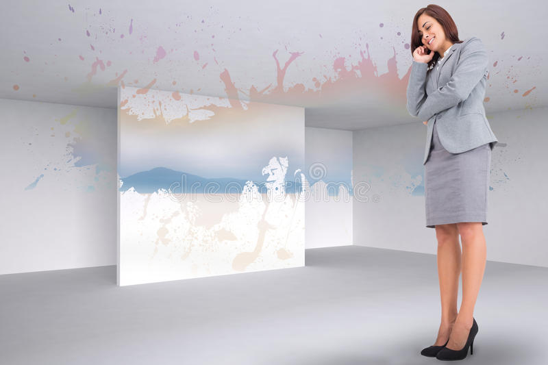 Composite image of smiling thoughtful businesswoman. Smiling thoughtful businesswoman against splash showing desert landscape stock photo