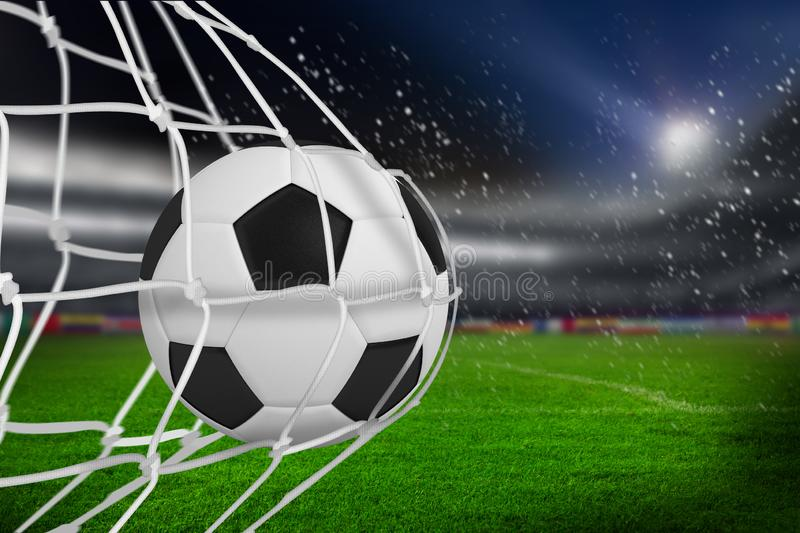 Composite image of soccer ball in goal net royalty free stock images