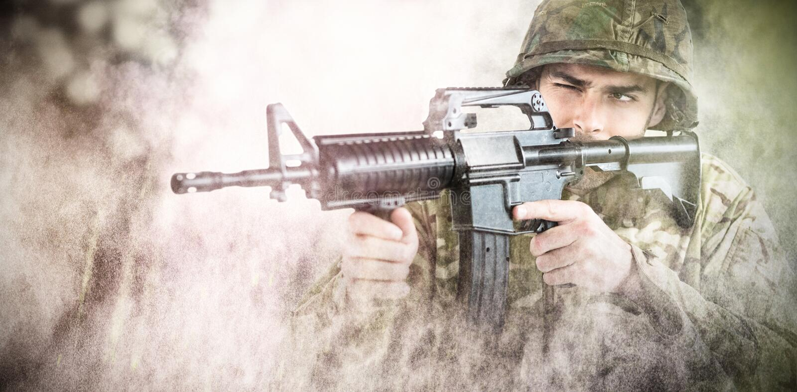 Composite image of soldier aiming with rifle royalty free stock photography
