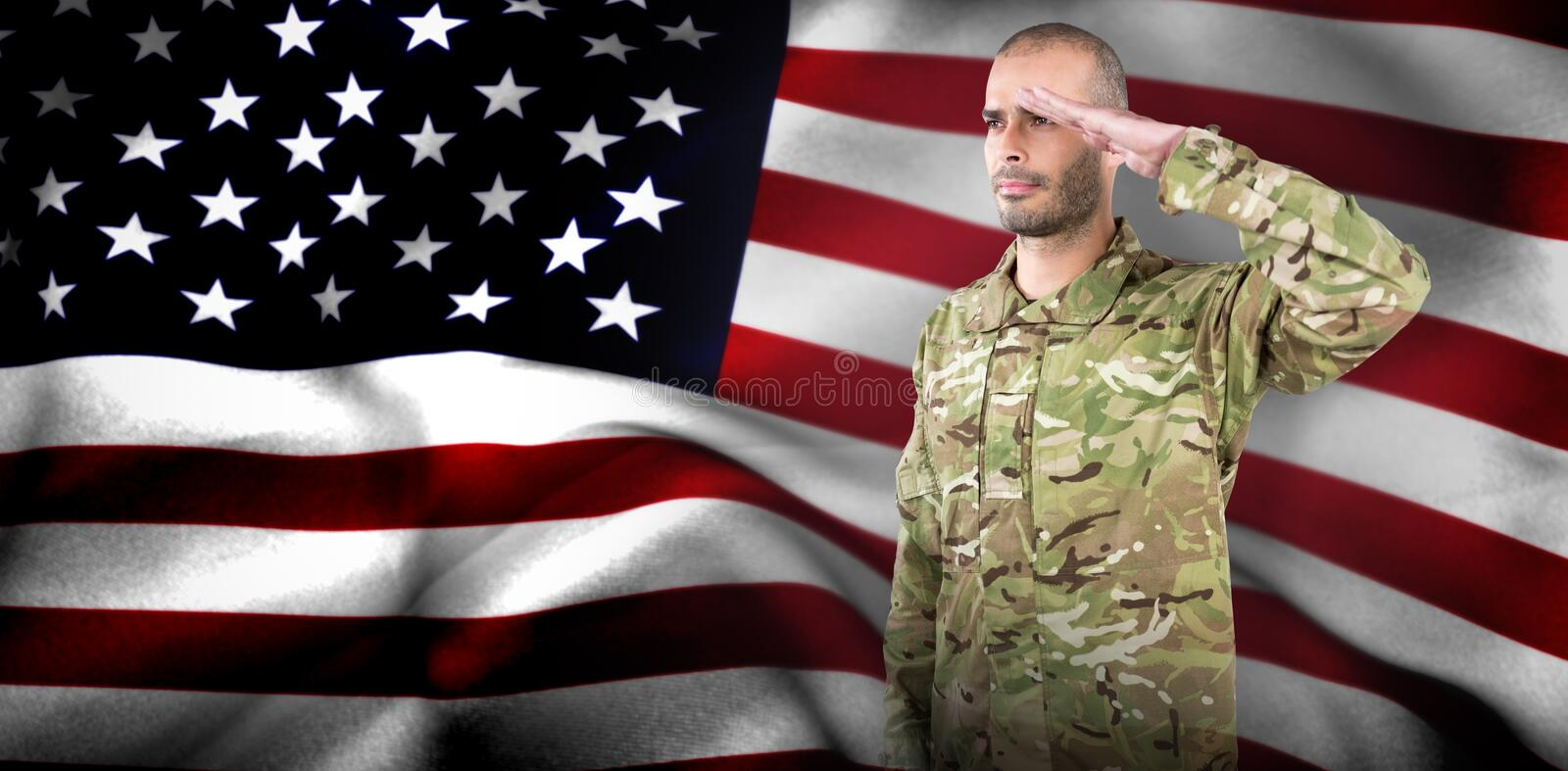 Composite image of soldier giving salute. Soldier giving salute against american flag stock photo