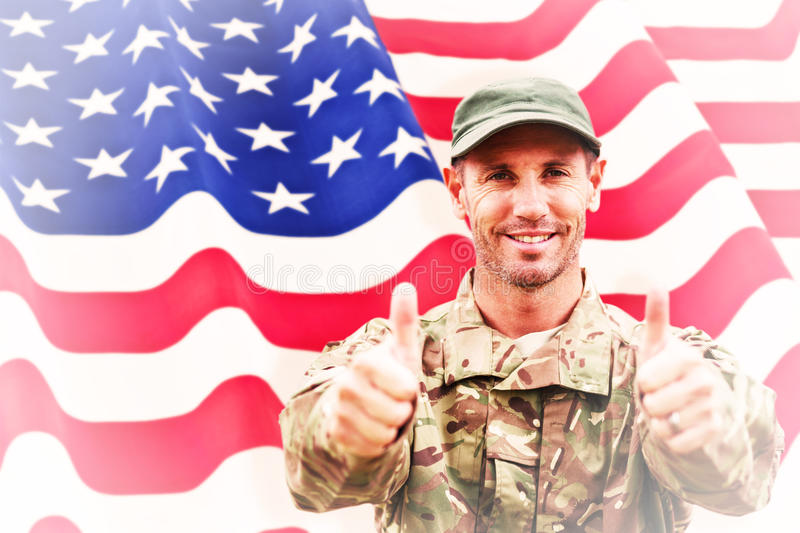 Composite image of soldier showing thumbs up stock images