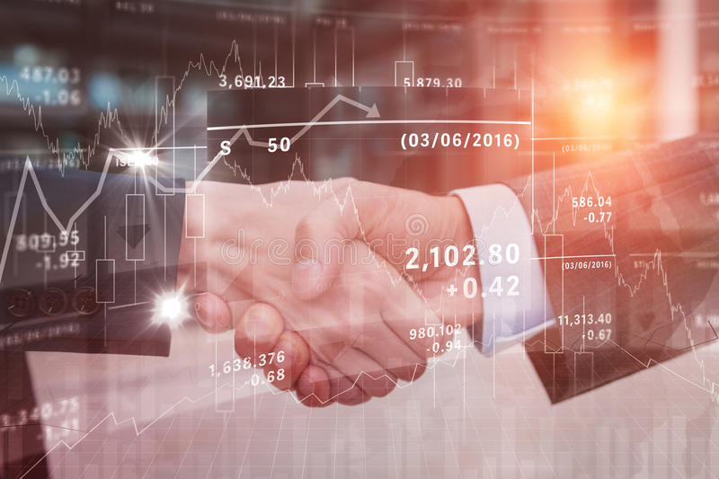 Composite image of stocks and shares. Stocks and shares against business colleagues handshaking stock photography