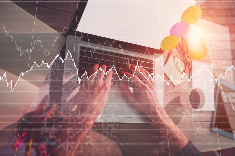 Composite image of stocks and shares. Stocks and shares against cropped image of graphic designer using laptop royalty free stock photos