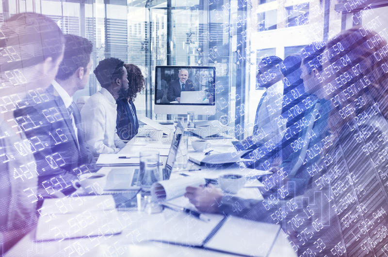 Composite image of stocks and shares. Stocks and shares against focused business people looking at screen during video conference stock images