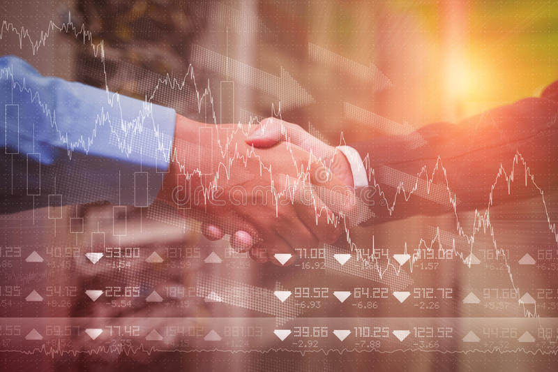 Composite image of stocks and shares. Stocks and shares against handshake of colleagues stock image