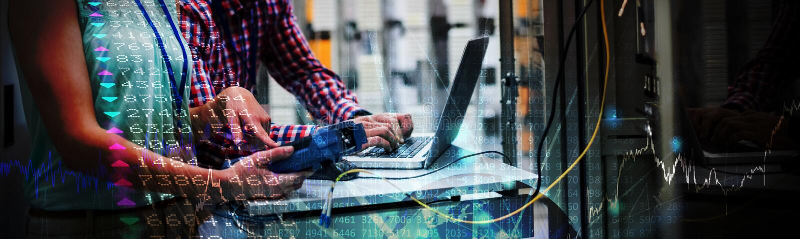 Composite image of stocks and shares. Stocks and shares against technicians using laptop while analyzing server royalty free stock photo