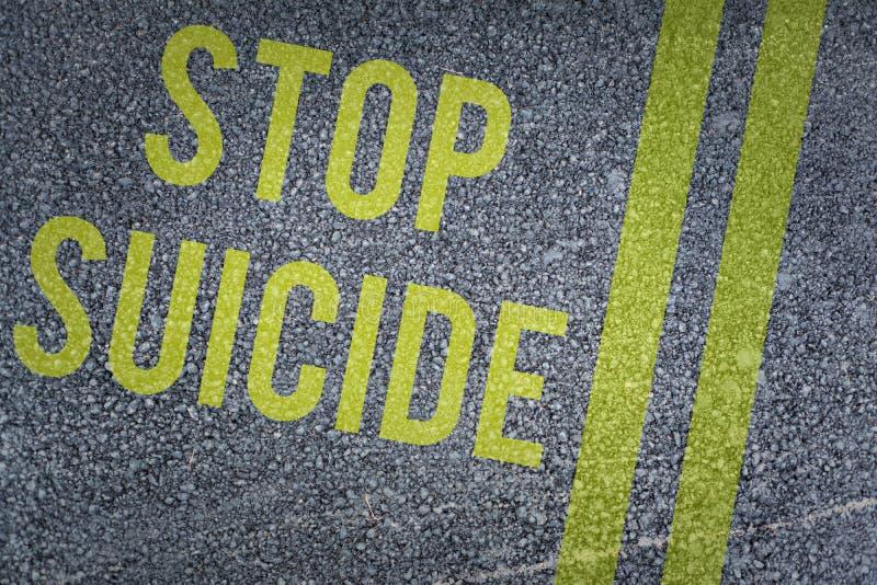 Composite image of stop suicide. Stop suicide against black road stock illustration