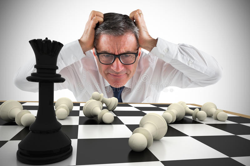Composite image of stressed businessman touching his head royalty free stock images