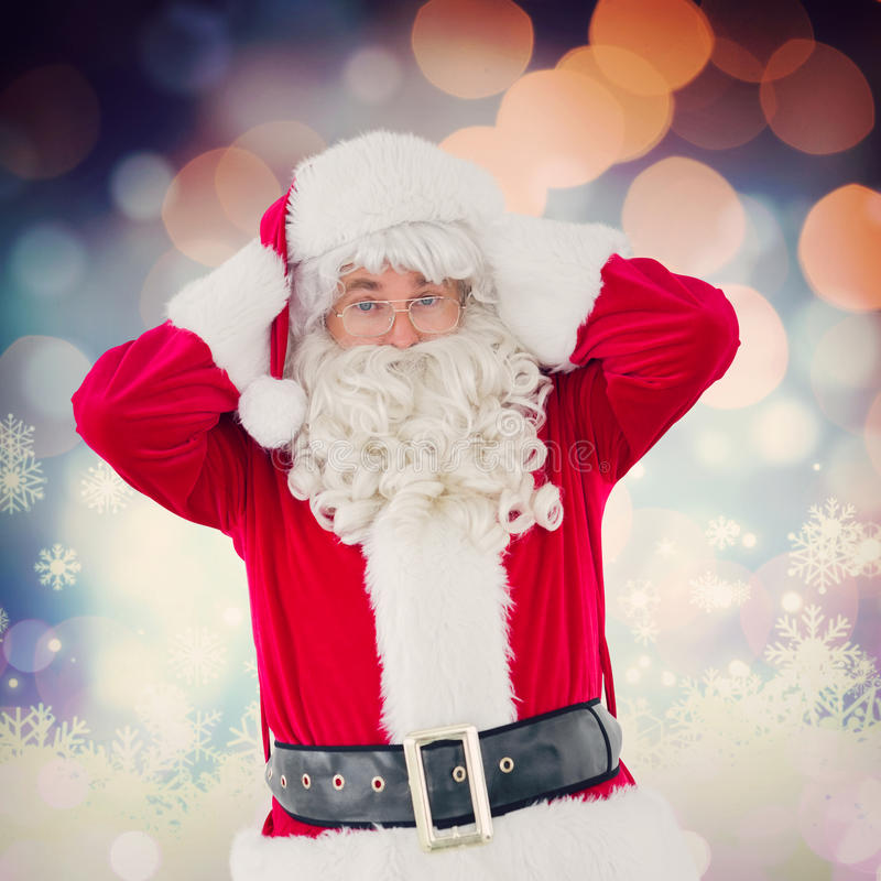 Composite image of stressed santa with his hands on head royalty free stock photography