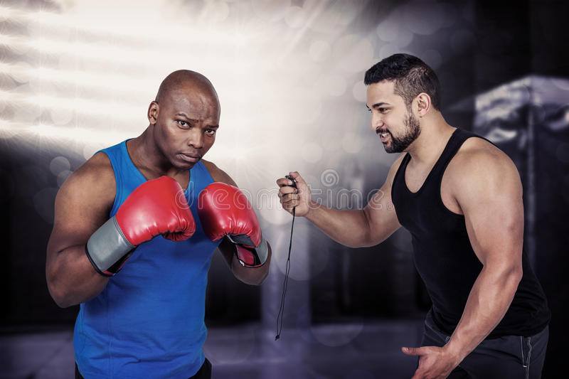 Composite image of strong friends using kettlebells together royalty free stock images