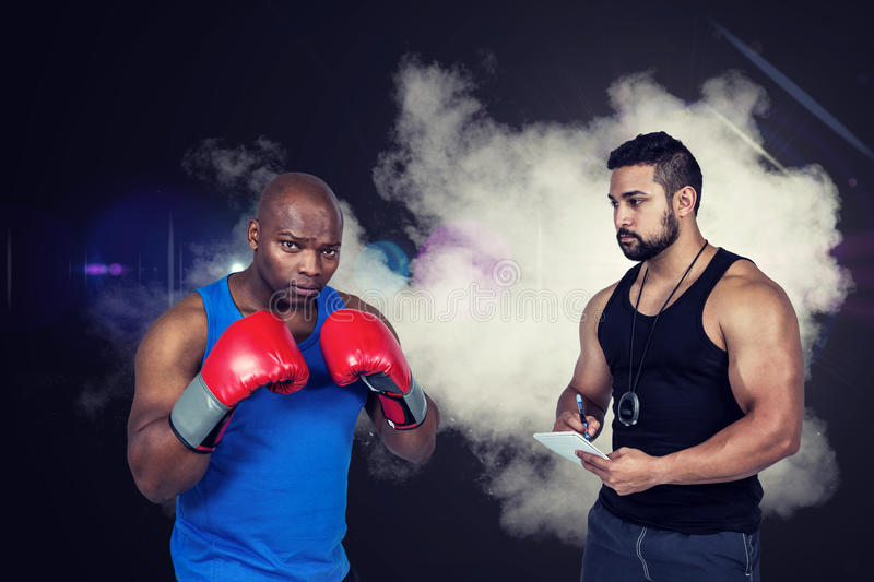 Composite image of strong friends using kettlebells together royalty free stock photos