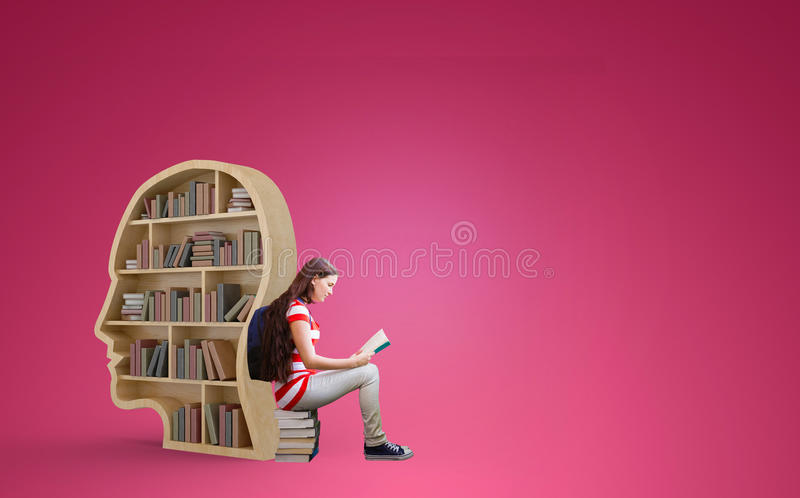 Composite image of student reading book in library royalty free stock photography