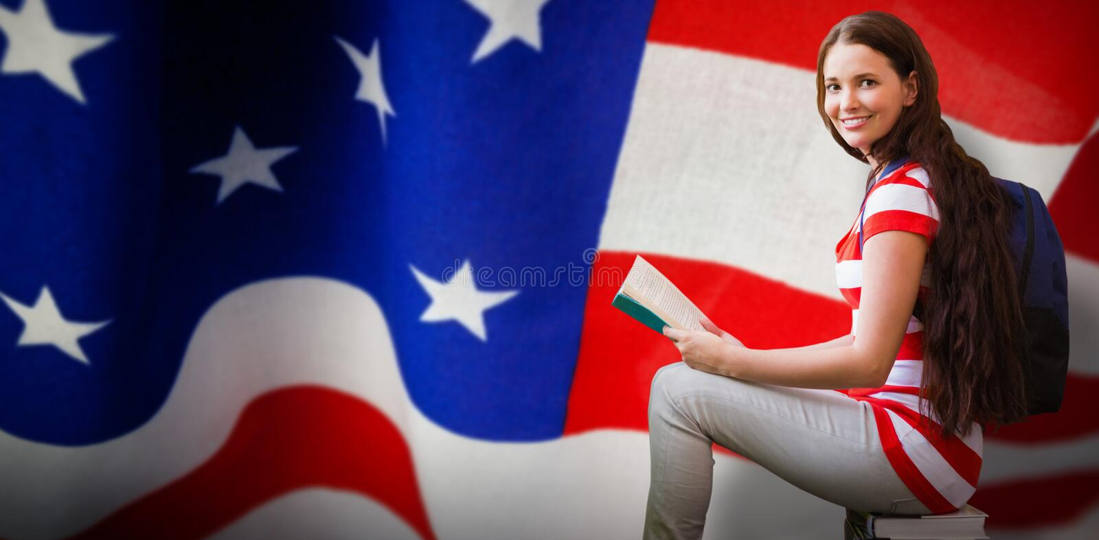 Composite image of student reading book in library stock image