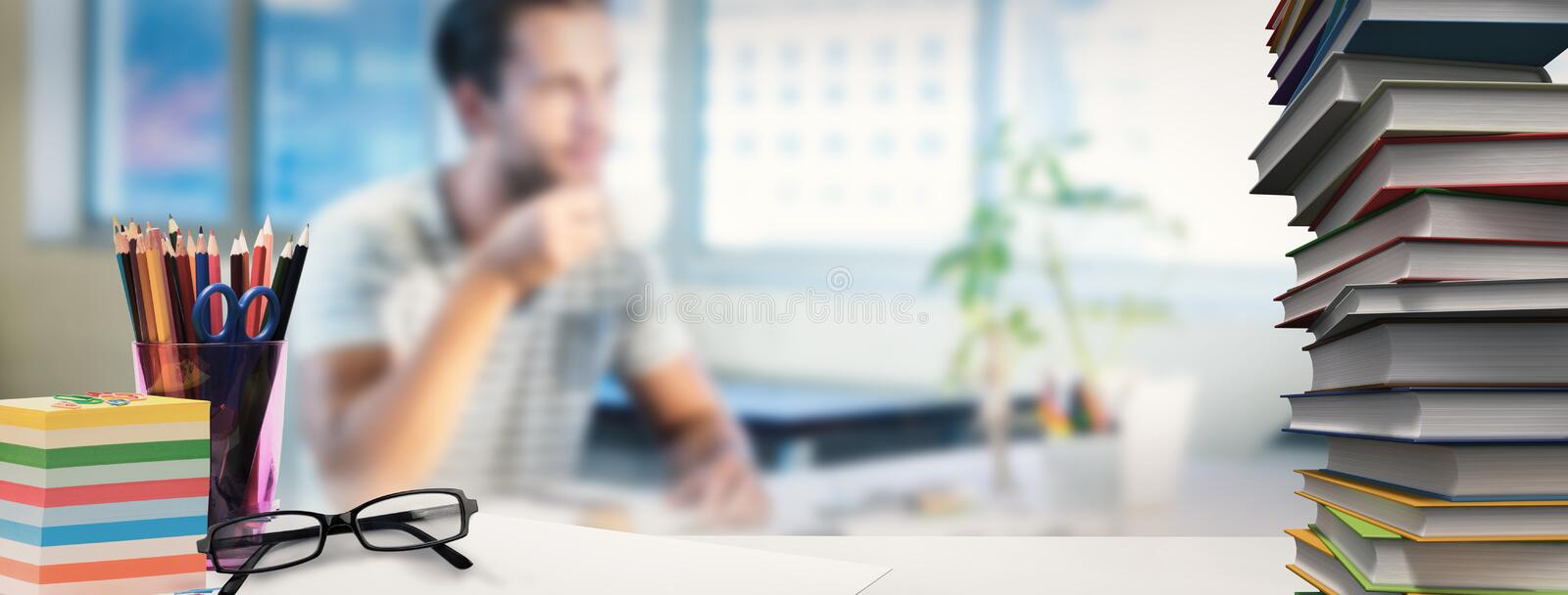 Composite image of students desk royalty free stock photography