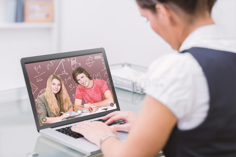 Composite image of students studying. Students studying against red stock image