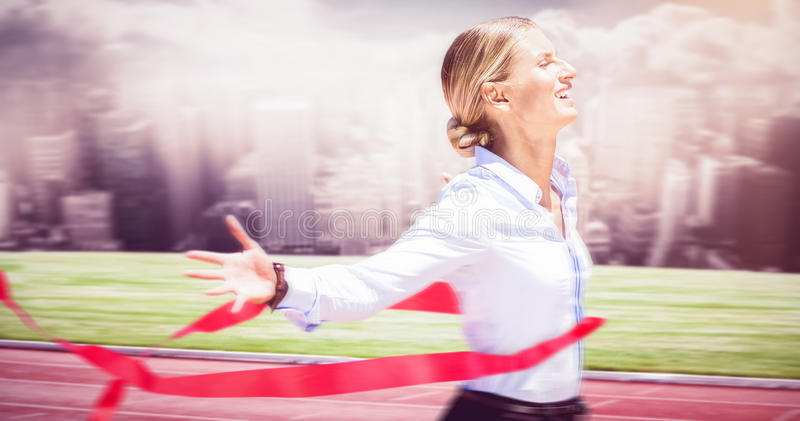 Composite image of successful businesswoman raising arms stock images