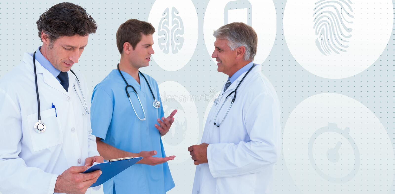 Composite image of team of serious doctors discussing. Team of serious doctors discussing against blue background royalty free stock photos