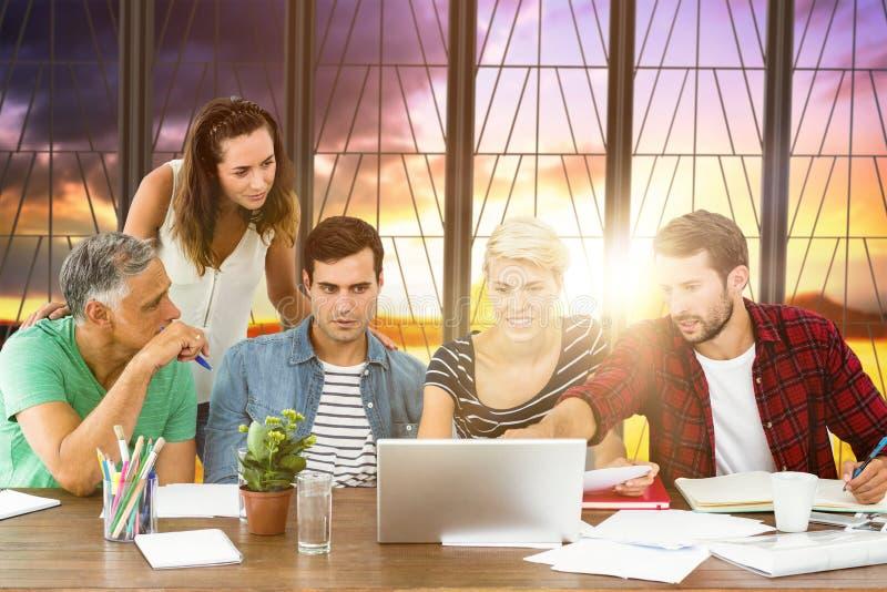 Composite image of teamwork using laptop together. Teamwork using laptop together against countryside scene royalty free stock image