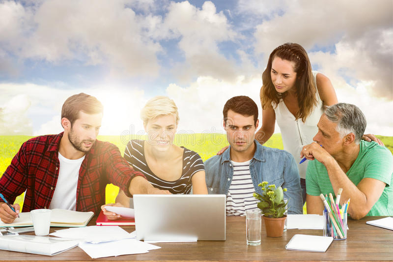 Composite image of teamwork using laptop together. Teamwork using laptop together against nature scene royalty free stock images
