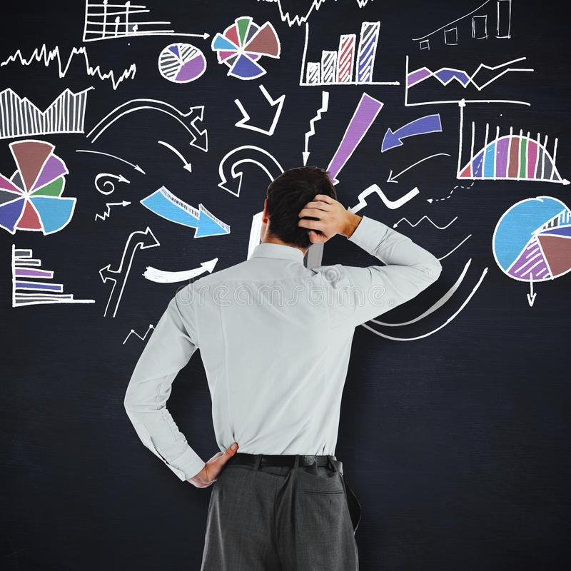 Composite image of thoughtful businessman with hand on head. Thoughtful businessman with hand on head against blackboard royalty free stock photo