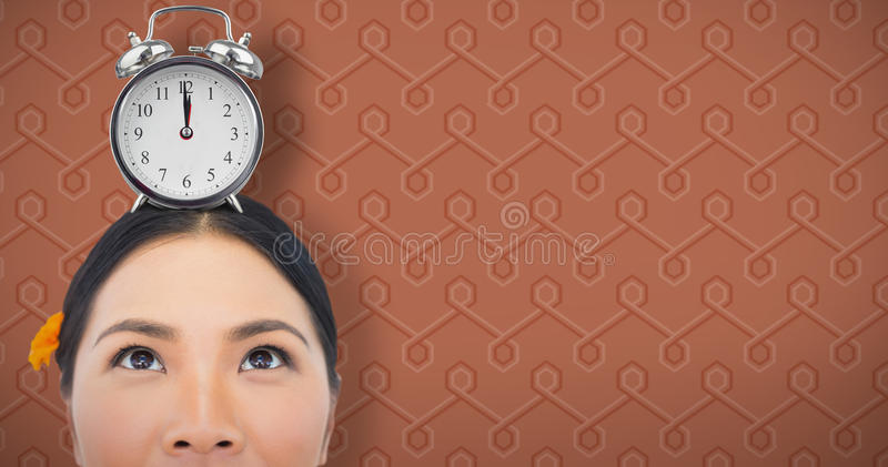 Composite image of thoughtful sensual model with orange flower in her hair stock photography