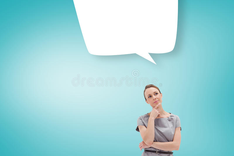 Composite image of thoughtful woman posing in dress with speech bubble royalty free stock photo