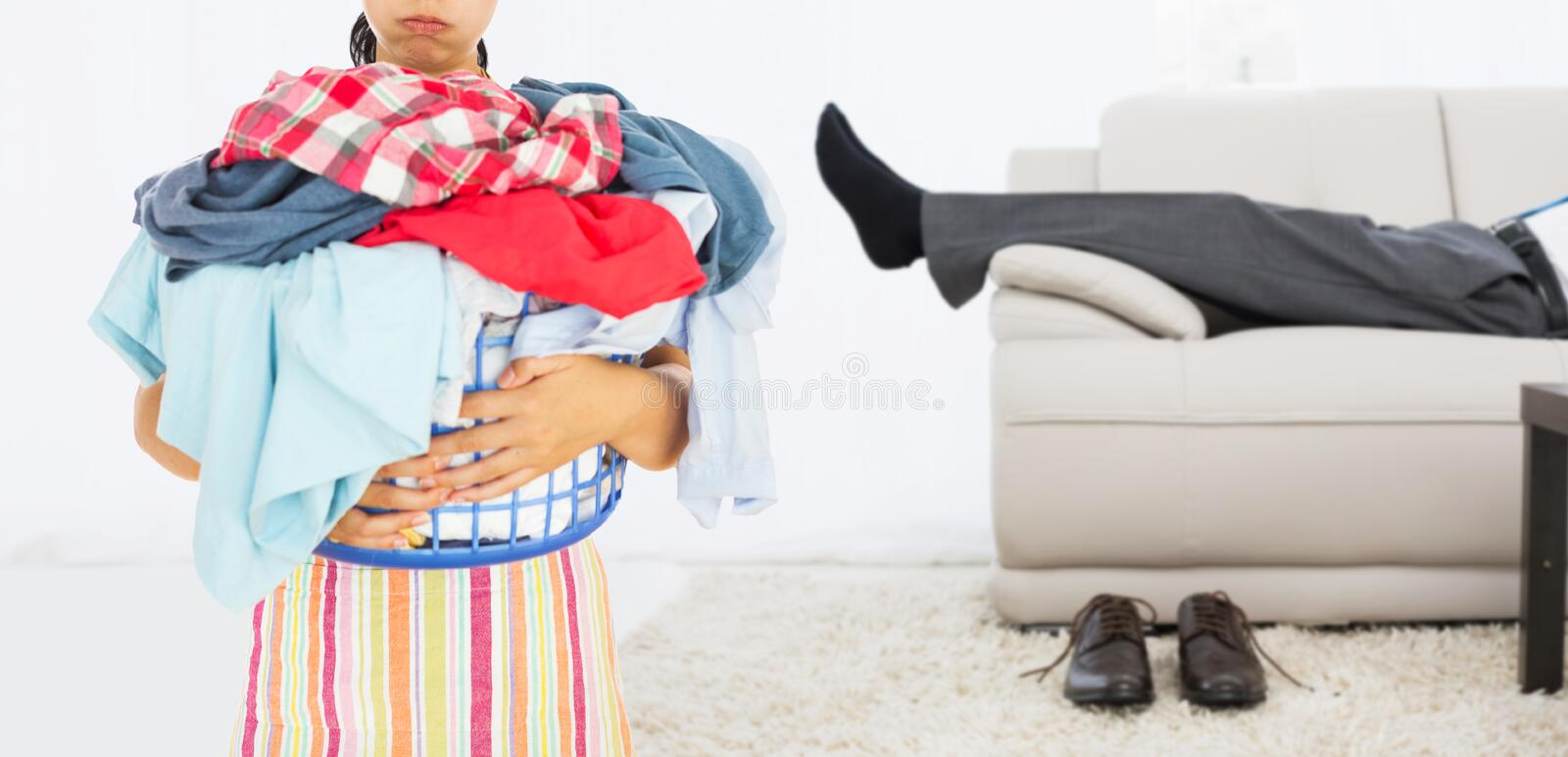 Composite image of tired woman holding full laundry basket royalty free stock images