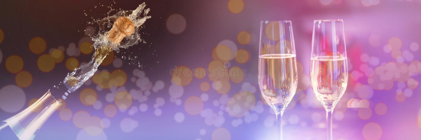 Composite image of two glasses of champagne. Two glasses of champagne against champagne cork popping stock photo