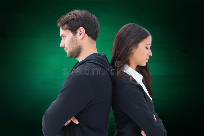 Composite image of unhappy couple not speaking to each other stock image