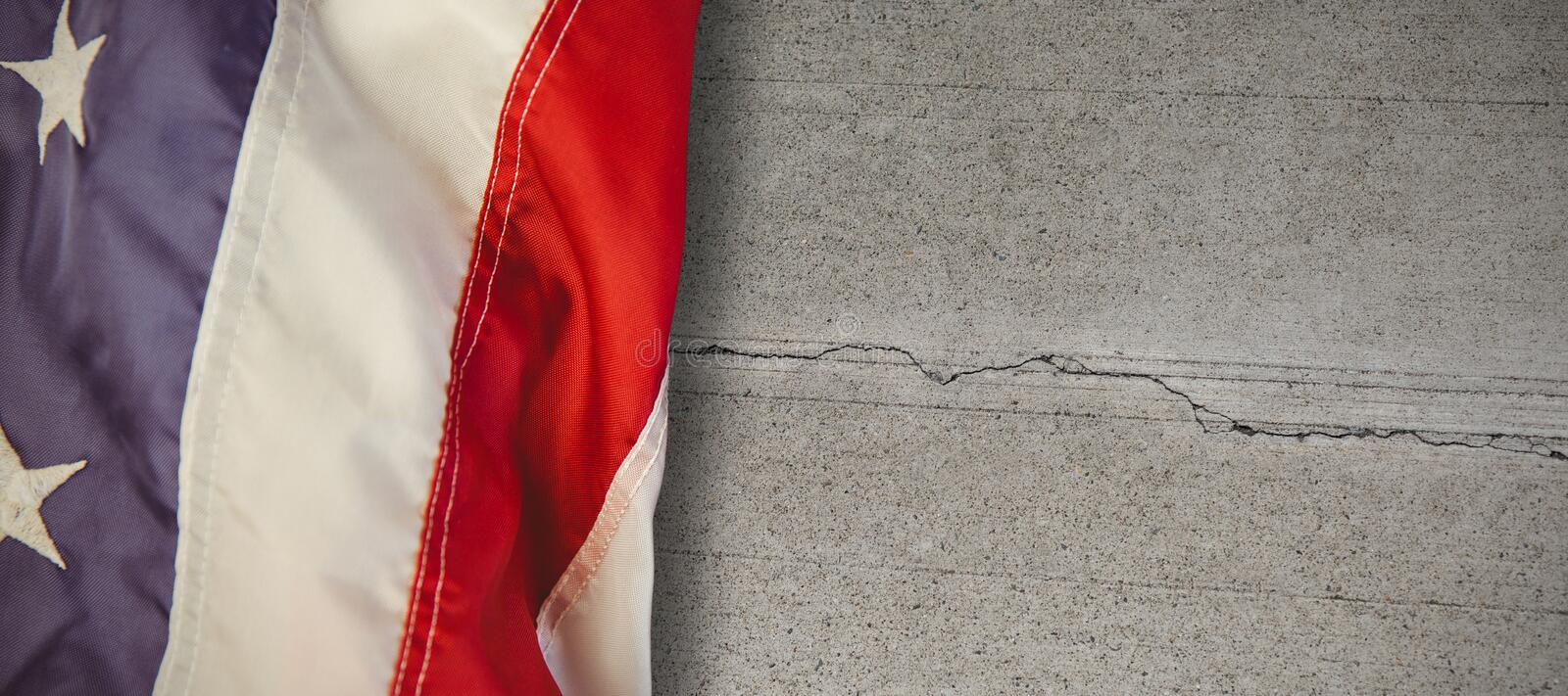 Composite image of us flag. US flag against concrete wall with crack royalty free stock photo