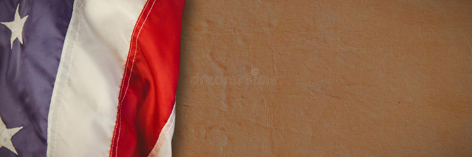 Composite image of us flag. US flag against full frame shot of wall royalty free stock images