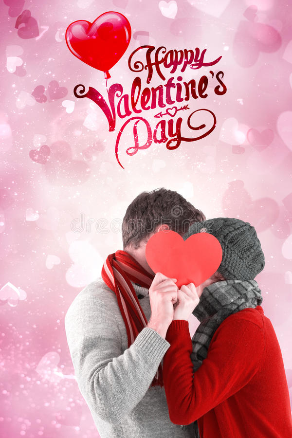 Composite image of valentines couple. Couple holding a red heart against valentines heart design stock images