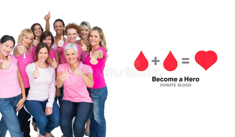 Composite image of voluntary cheerful women wearing pink for breast cancer stock photography