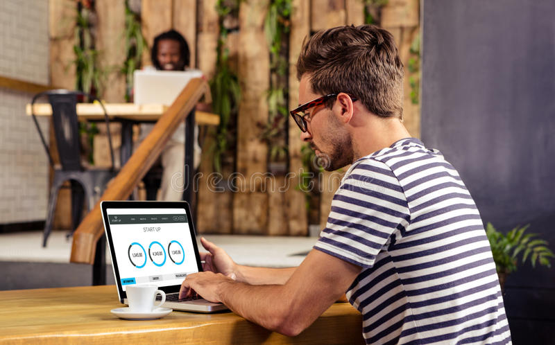 Composite image of web page showing statistics. Web page showing statistics against men using laptop royalty free stock photography
