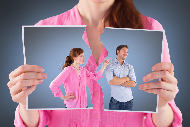 Composite image of woman arguing with uncaring man. Woman arguing with uncaring men against grey vignette stock images