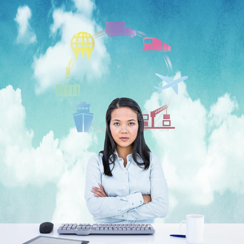 Composite image of woman with arms crossed looking at camera. Woman with arms crossed looking at camera against blue sky stock photo